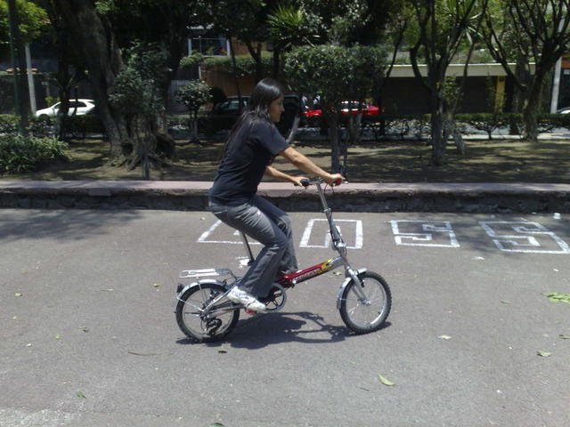 Nadezhda riding the new foldable bike
