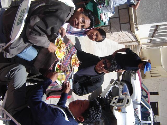 Local gang having picante de pollo