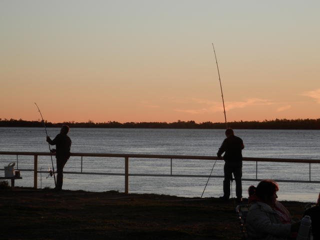 Fishers by the Paraná river