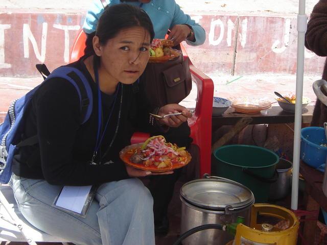 Local girl having picante de pollo