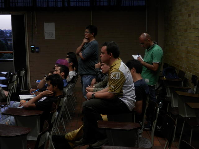 The students following Kaz's explanation of ext4
